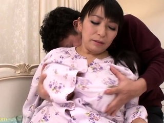 Asian with heavy boobs with hairy pussy is being drilled