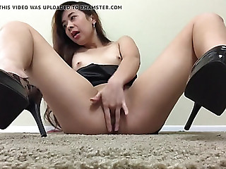 Oriental in high heels fucking vibrator